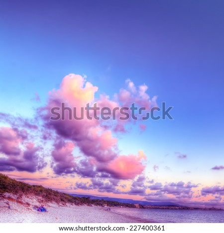 soft clouds over Alghero at sunset. Heavy processed for hdr tone mapping effect. - stock photo