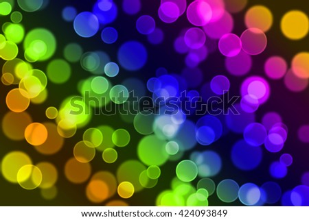 Soft colorful bokeh on black background. Defocused blurry circle lights