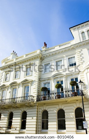 Soft coloured facades of large houses in London's wealthy neighborhood Notting Hill. - stock photo