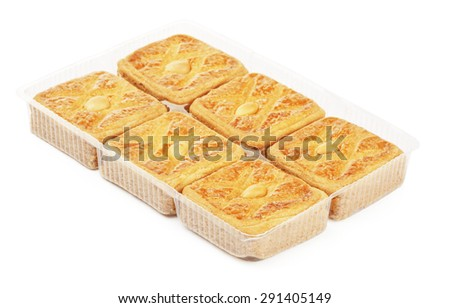 soft cookies with almond in plastic packaging, isolated - stock photo