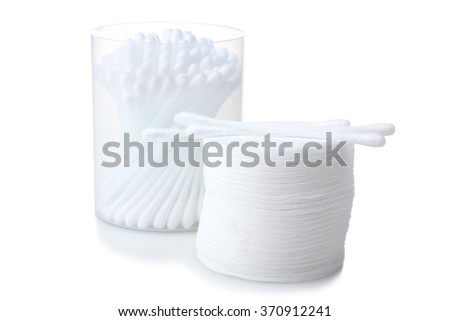 soft cotton pads neatly folded stack of cotton swabs and folded in a plastic cylinder isolated on white background - stock photo