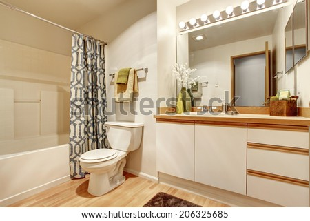 Soft creamy bathroom interior with bathroom vanity cabinet with mirror - stock photo