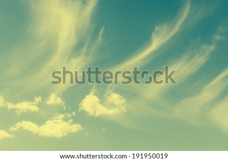 Soft cumulus and wispy clouds formation in retro vintage old film camera effect. - stock photo