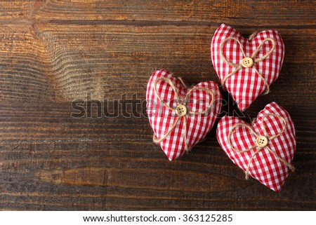 soft decorative heart on wooden brown table - stock photo