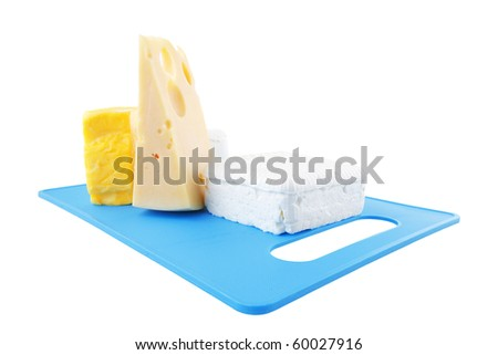soft delicious cheeses on blue plastic board - stock photo