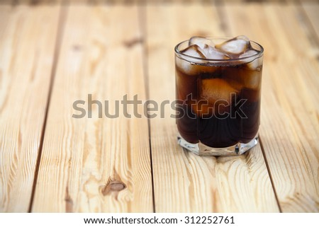 soft drink on a wooden background - stock photo