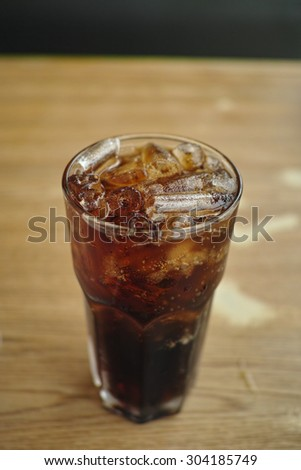 soft drink soda on the wood desk - stock photo
