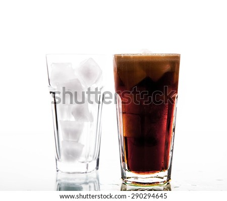 soft drinks. Cola glass with ice cubes over white - stock photo