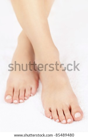 Soft female feet with pedicure close up - stock photo