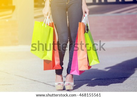 Soft focus and Blurry of happiness, consumerism, sale and people concept - smiling young woman asian with shopping bags