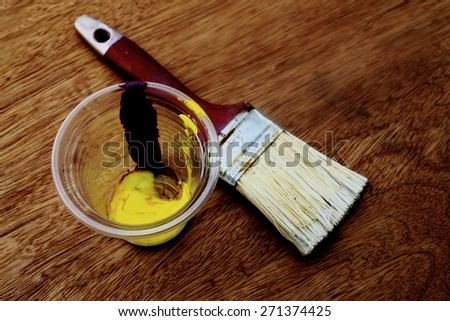 soft focus and dark tone image of used brush and watercolor in cup  - stock photo