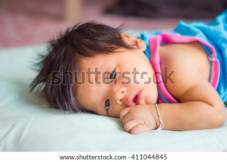 Soft focus and selective focus of cute baby lie prone. - stock photo