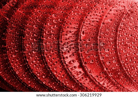 Soft focus Blue-ray, DVD or CD disc with drop colour background - stock photo
