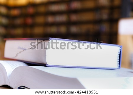 Soft focus books in the library and blurred book shelves. - stock photo