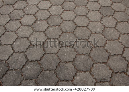 Soft Focus Cement brick floor background,Grey Pavement with Honeycombs. Seamless Tileable Texture. - stock photo