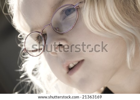 Soft Focus close up image of a child with glasses