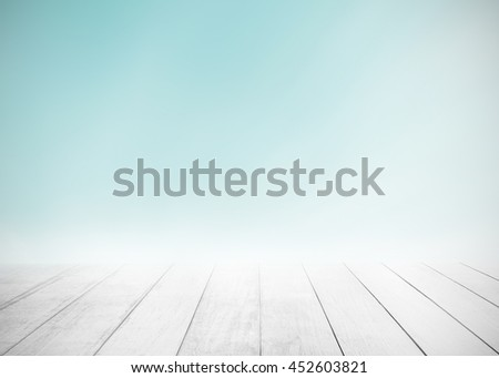 Soft focus clouds sky background with old wood floor. Blur blue pastel sunlight day time backdrop. Abstract blurred on vacation summer ocean beach. Wooden stage for watching nature. Open view heaven. - stock photo