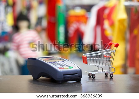 Soft Focus : Credit Card Machine With Shopping Cart In The Store - stock photo