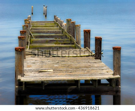 Soft Focus Image of an Old Abandoned Boat Dock - stock photo