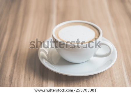 Soft focus Latte coffee cup - vintage effect - stock photo