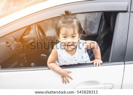 Soft focus Little girl in the car looking throw window.vintage tone