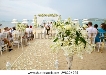 soft focus of beautiful flower decoration in the beach wedding ceremony - stock photo