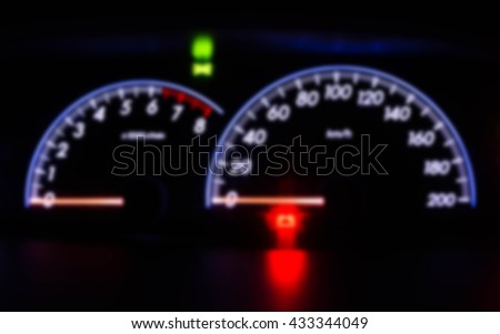 soft focus of car's Speedometer illuminated with light reflection