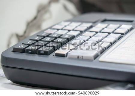 Soft focus Of Cash Register With Printed Receipt