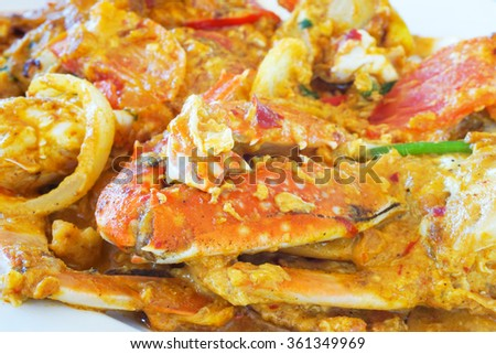 soft focus of homemade stir-fried crab in yellow curry powder - stock photo