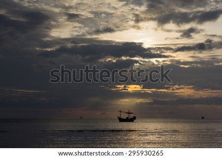 soft focus of In the morning the sea was going to rain. A boat floats in the light of the sun shines a little. Silhouette style image