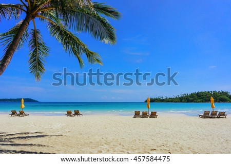 soft focus of Sandy tropical beach with deck chairs in sunny day