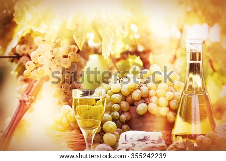 Soft focus on grapes and wine - stock photo