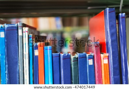 soft focus or blur motion of old book on shelf in public library.