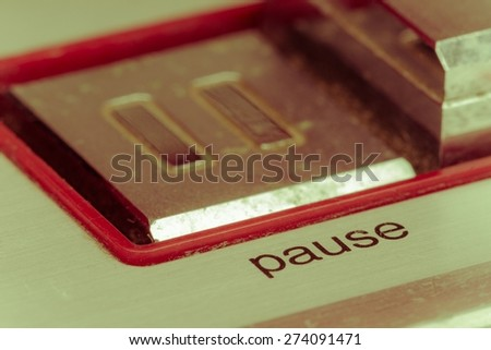 soft focus pause button, focusing on the word pause, vintage style - stock photo