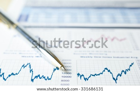 Soft focus pen on financial graph background