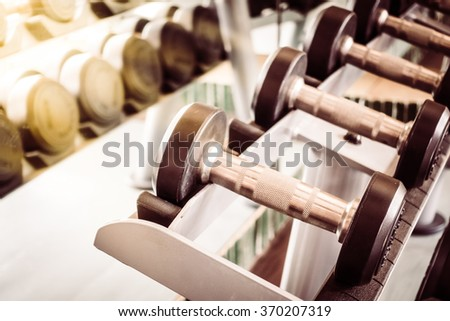 Soft focus point Dumbbell equipment in fitness gym room - Vintage Filter