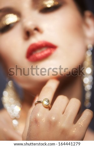 Soft focus portrait of beautiful young woman with shining face makeup  - stock photo