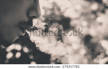 soft focus ,selection focus area , blurred background ,man smoking : color filter  - stock photo