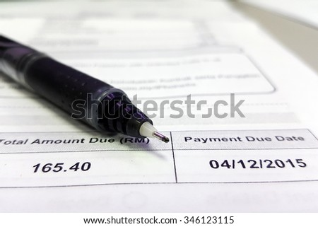 Soft focus, selective focus, blurry image of bill statement in vintage color - stock photo