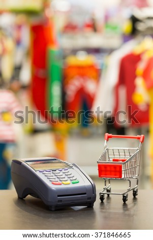 Soft Focus : Shopping Cart With Credit Card Machine In The Store - stock photo
