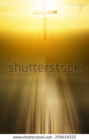 soft focus silhouette of cross on sunset background with light effect - stock photo