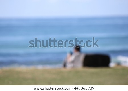 Soft Focus Single Person looking at the Ocean - stock photo