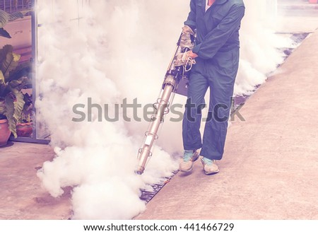 Soft focus the man fogging to eliminate mosquito for prevent spread dengue fever - stock photo