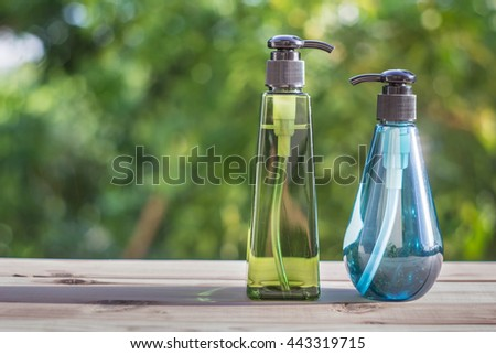 Soft focus used hand gel in pump bottle - stock photo