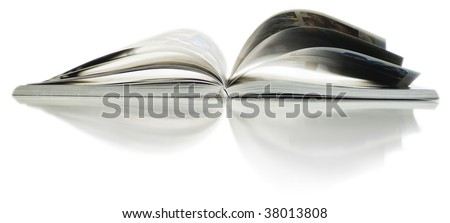 Soft focus view of opened color magazine with reflection. Close-up. - stock photo