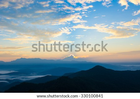 soft focused,blurry,art tone of sunset in the mountains landscape - stock photo
