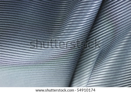 Soft folds on the gray glossy silk - stock photo