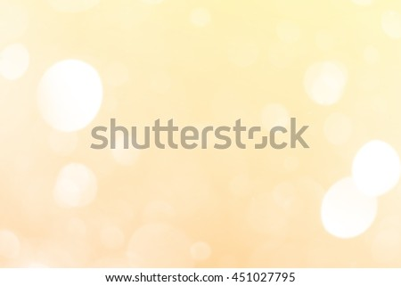 soft gold blurred light bokeh background, copyspace in central of image for business presentation background or wallpaper - stock photo