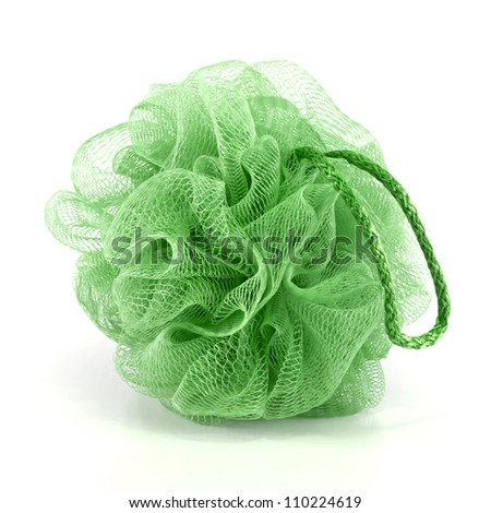 Soft green bath puff or sponge with rope handle isolated on white background. - stock photo