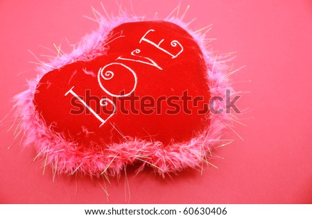 Soft Heart love cushion isolated on pink background - stock photo